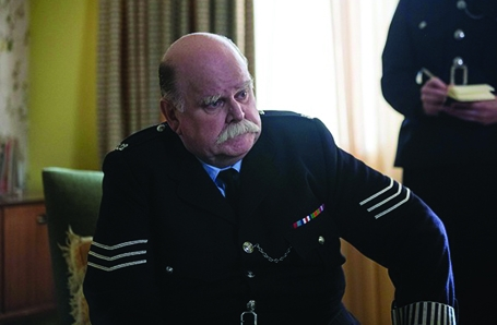 Trevor Cooper as regular character Sergeant Woolf in BBC1's CALL THE MIDWIFE